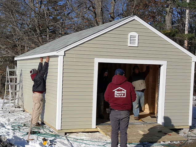 men working on shed