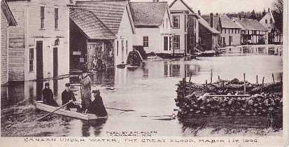 historic photo of men in boat in floodwaters downtown