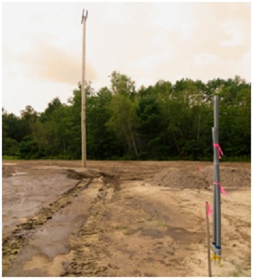 poles and dirt installation at new Elliot Field