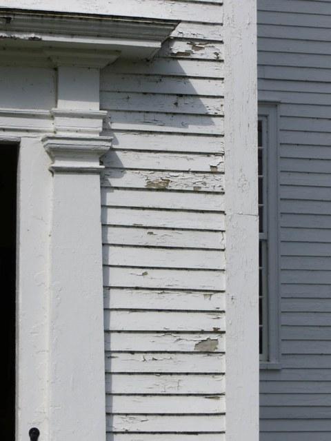 peeling paint near meeting house entrance
